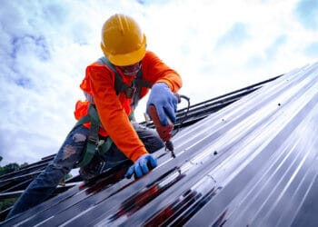 Contractor Working on a Commercial Roof Replacement Colorado Springs CO