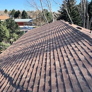 The after photo of a roof replacement for a home prior to sale in Colorado Springs